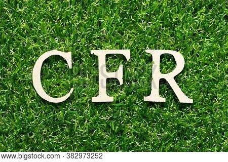 Wood Alphabet Letter In Word Cfr (abbreviation Cost And Freight) On Green Grass Background