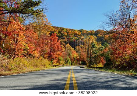 Cherohala Skyway crosses the boundaries of the Cherokee and Nantahala National Forests leading to the name Cherohala a combination of the two forest names. It is autumn of the year with colorful leaves in October. Tennessee USA. poster