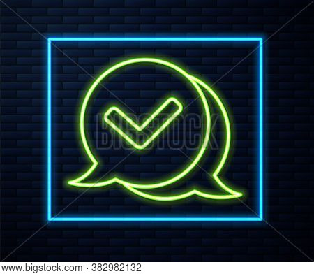 Glowing Neon Line Check Mark In Speech Bubble Icon Isolated On Brick Wall Background. Security, Safe