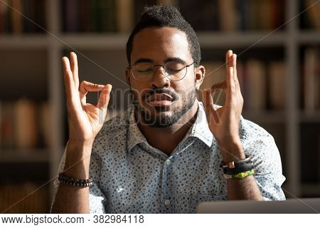 Close Up Mindful African American Man Wearing Glasses Meditating