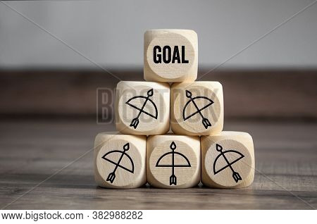 Cubes And Dice With The Goal Or Target Wooden Background
