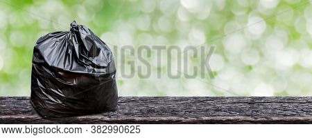 Plastic Garbage Bag On Wood Plank For Background, Trash Bag Package For Recycle Waste, Bag Plastic W