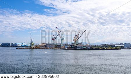 Industrial Port Landscape View Over Blue Sky And White Cloud From The Ferry Boat In The Ocean At Sur