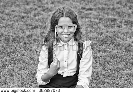 Last Day Of School. Happy Girl Hold Prop Glasses Green Grass. Little Child With School Look. School