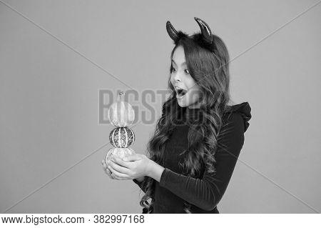 Surprise Trick. Surprised Child Hold Pumpkin Stack Orange Background. Little Girl Wear Red Devil Hor
