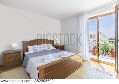 Inetrior Detail Of Modern Bedroom And Balcony View