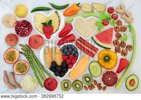 Health food for a healthy heart with super foods to support the cardiovascular system with low GI for diabetics. High in antioxidants, fibre, protein, omega 3 & anthocyanins. Flat lay.