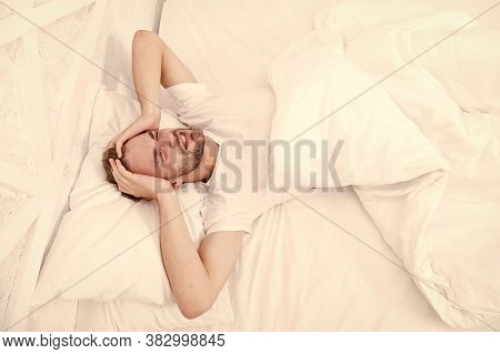 Sleep Problems Can Lead To Headaches In Morning. Handsome Man Relaxing In Bed. Snoring Can Increase