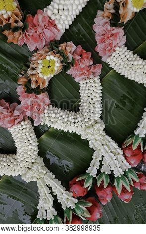 Beautiful Thai Traditional Garlands On Banana Leaf, Fresh Flower Garland, Top View Vertical Image.