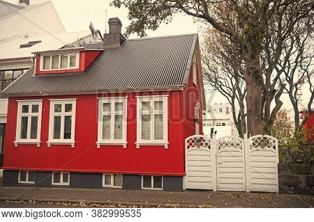 Building Facade With Red Wall And White Window Frames. Architecture Design Concept. Scandinavian Hou