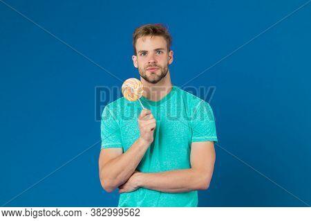 Lollipop Fun. Man Eat Big Colorful Sweet Lollipop. Man With Bristle Likes Lollipop. Cheat Meal Conce