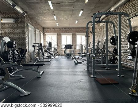 Gym For Bodybuilding. Heavy Dumbbells And Exercise Equipment. Barbells And Equipment For Athletes.