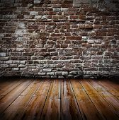 Grunge old interior with brick wall and wooden floor poster