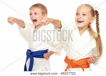 Boy and girl in kimono beat hand