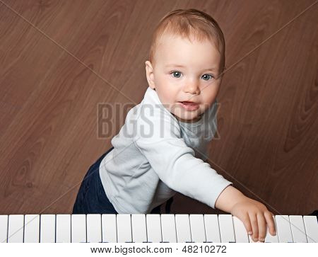 Child  Play Music On Piano Keyboard