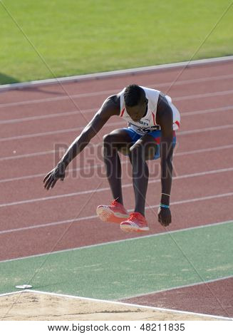 DONETSK, UKRAINE - JULY 12: Lazaro Martinez of Cuba competes in the triple jump during 8th IAAF World Youth Championships in Donetsk, Ukraine on July 12, 2013