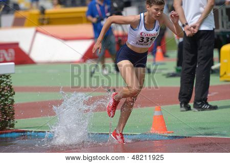 DONETSK, UKRAINE - JULY 12: Julie Op'T'Hoog of France competes in 2000 m steeplechase during 8th IAAF World Youth Championships in Donetsk, Ukraine on July 12, 2013