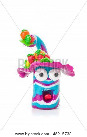 Handmade modeling clay figure with fruits on a white background