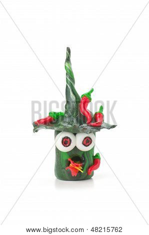 Handmade modeling clay figure with chilies on a white background