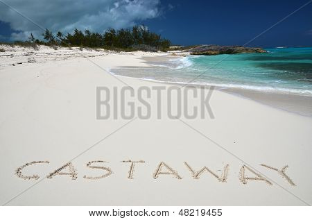 ay writing on a desrt beach of Little Exuma, Bahamas