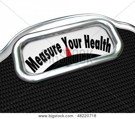 The words Measure Your Health on a scale for weighing yourself and getting healthy through weight loss and exercise