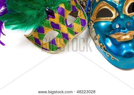 Various colored Mardi gras masks on a white background