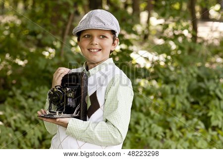 Retro style young photographer