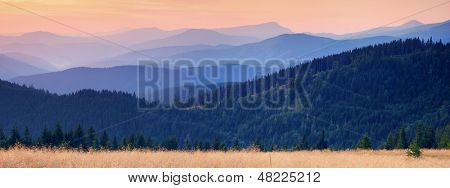 Landscape with a mountain panorama view at sunset