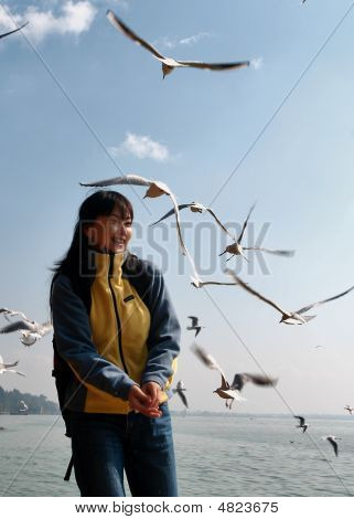 A Girl Playing With Seagull