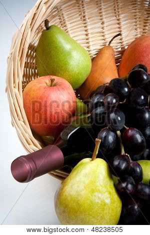 Tantalizing Fruit in Basket with Wine Bottle