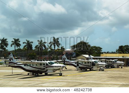 Short range planes ready for passengers at Philip S. W. Goldson Airport in Belize