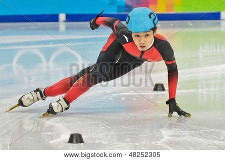 INNSBRUCK, AUSTRIA - JANUARY 18 Xiucheng Lu (China) wins the men's 1000m  short track C final on January 18, 2012 in Innsbruck, Austria.