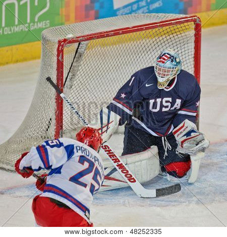 INNSBRUCK, AUSTRIA - JANUARY 18 Alexander Protapovich (Russia) tries to score a goal as Russia beats the USA 7:1 in the men's ice hockey tournament on January 18, 2012 in Innsbruck, Austria.
