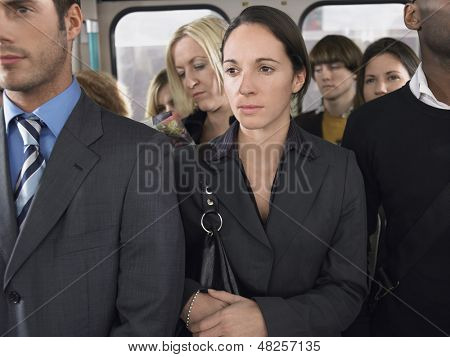 Group of multiethnic commuters standing in a train poster