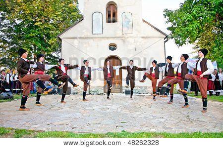 SIROGOJNO, SERBI - JULY 12: Dancers of Folklore ensembles on festival Petrovdan's days on July 12, 2013. in Sirogojno, Zlatibor, Serbia.