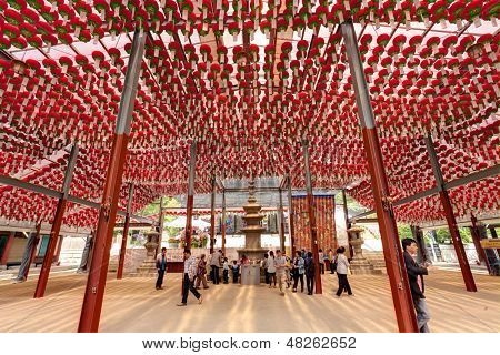 SEOUL KOREA MAY 11:People visiting the Bongeun-sa Temple which decorated by a lot of red lanterns for celebration of Buddha's birthday on may 11 2013 Seoul, South Korea.