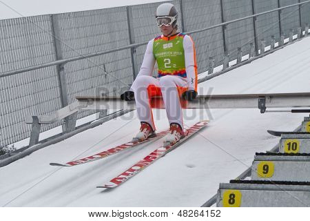 SEEFELD, AUSTRIA - JANUARY 19 Colton Kissel (USA) prepares to go down the ski jump in Seefeld during a training session on January 19, 2012 in Seefeld, Austria.