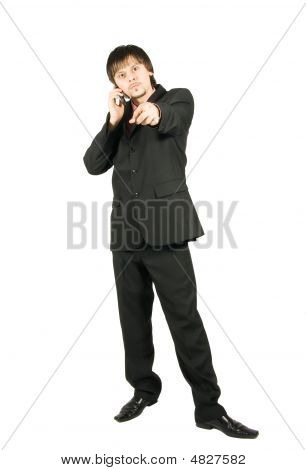 Angry Businessman Talking By Cellular And Pointing At You