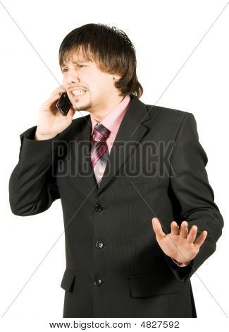 Frustrated Businessman Calling On The Cellular Phone Isolated On White