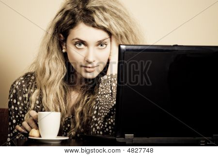 Beautiful Young Woman In Cafe With Laptop