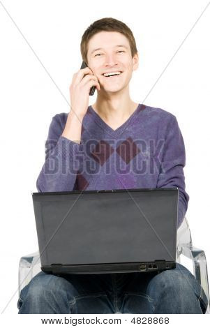 Happy Young Man With Laptop And Phone