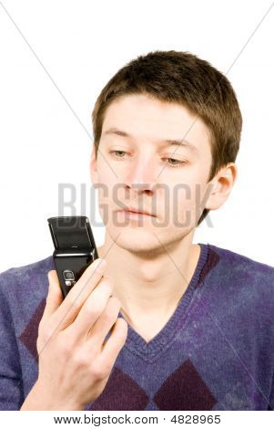 Casual Man Reading A Sms Isolated On White