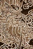 Dragon in traditional Thai art on church door pieced from pieces of oyster shell Bangkok Thailand. poster