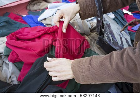 Rummaging On A Clothes Stall