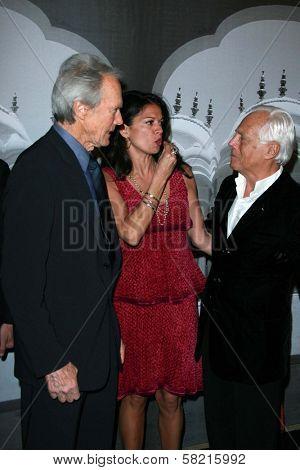 Clint Eastwood with Dina Eastwood and Giorgio Armani at the Giorgio Armani Prive Show to celebrate the Oscars. Green Acres, Los Angeles, CA. 02-24-07