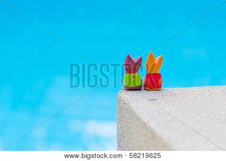kittens dolls in luxury resort near the swimming pool poster