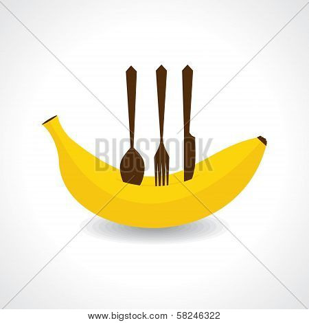 A fork,knife and spoon on the fresh banana
