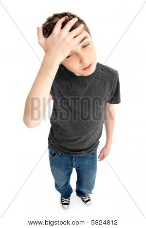 Above perspective of a pre teen boy frustrated tired or worried. Focus to face shadow left under feet. poster