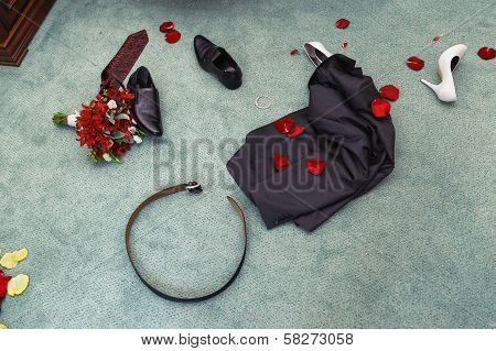 Disrobed Wedding Clothes. Straggle Objects. Shues, Suit, Bouquet, Belt, Necktie