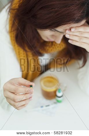 Vitamins, medicines and hot lemon tea for a woman who got caught
